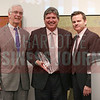 Charles Bowman, Bank of America Charlotte market president, and Kevin Pitts, CBJ Publisher, present Tom Skains, CEO Piedmont Natural Gas, with the Business Person of the Year Award at the CBJ Book of Lists Gala held at the Foundation For The Carolinas on Jan. 28.