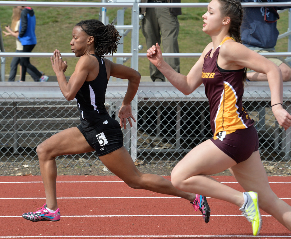 """Peak to Peak's Janelle Taylor runs in the 100 meter dash at the 2016 Boulder Snow Invite at Broomfield High School on Saturday.<br /> More photos:  <a href=""""http://www.BoCoPreps.com"""">http://www.BoCoPreps.com</a><br /> David R. Jennings/Staff Photographer<br /> March 12, 2016"""