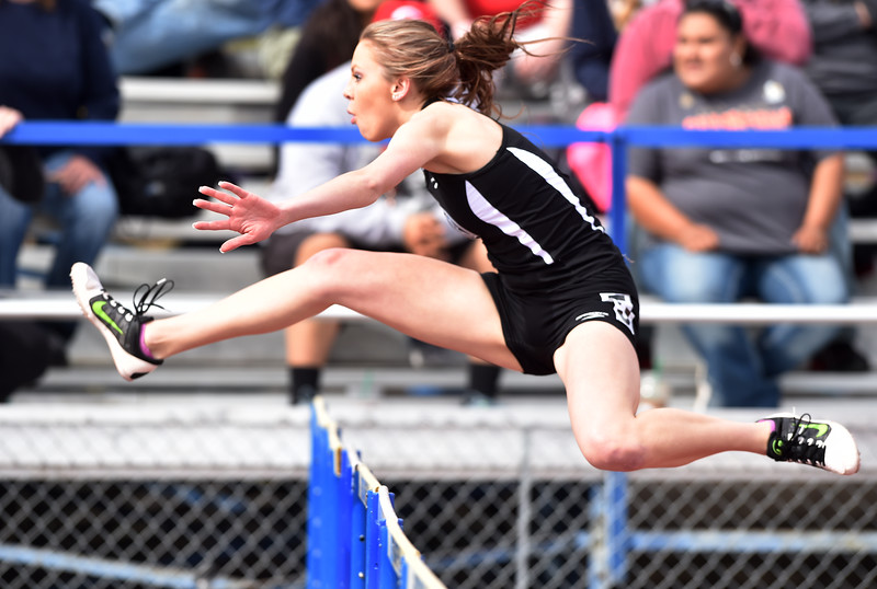 """Mountain Range's Kim Cunninghamruns in the 100 meter hurdles at the 2016 Boulder Snow Invite at Broomfield High School on Saturday.<br /> More photos:  <a href=""""http://www.BoCoPreps.com"""">http://www.BoCoPreps.com</a><br /> David R. Jennings/Staff Photographer<br /> March 12, 2016"""