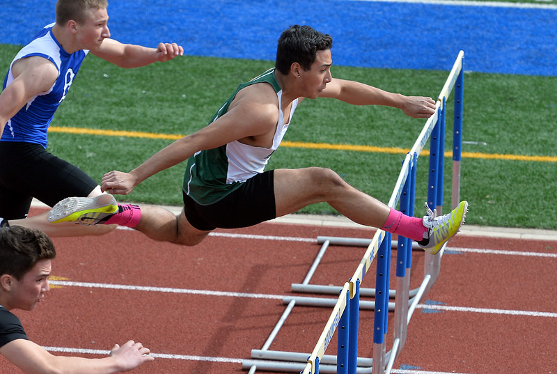 "Niwot's Nelson Menjivar runs in the 110 meter hurdles at the 2016 Boulder Snow Invite at Broomfield High School on Saturday.<br /> More photos:  <a href=""http://www.BoCoPreps.com"">http://www.BoCoPreps.com</a><br /> David R. Jennings/Staff Photographer<br /> March 12, 2016"