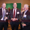 Rick Puckett, CFO at Snyder's-Lance, Inc., poses for a photo with friends Kevin White and Tom Gabbard.
