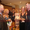 Finalist Brian Musgrave talks with his wife Jen Musgrave and friends at the CFO of the Year Awards.