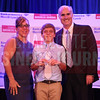 Ryan Russell posees for a photo with his family after winning the JA BizTown CFO of the Year Award.
