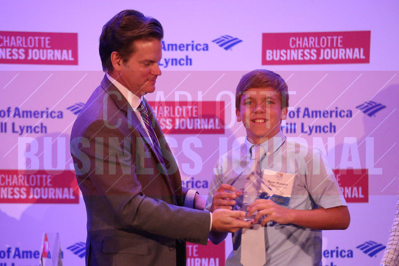 CBJ Publisher Kevin Pitts gives Ryan Russell the JA BizTown CFO of the Year Award.
