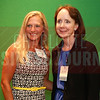 Jinger Kelley of J-Book Services poses for a picture in the photo booth with winner Vicki Hafele of Duncan-Parnell, Inc.