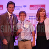 CBJ Publisher Kevin Pitts and Joy Goble give Ryan Russell the JA BizTown CFO of the Year Award.