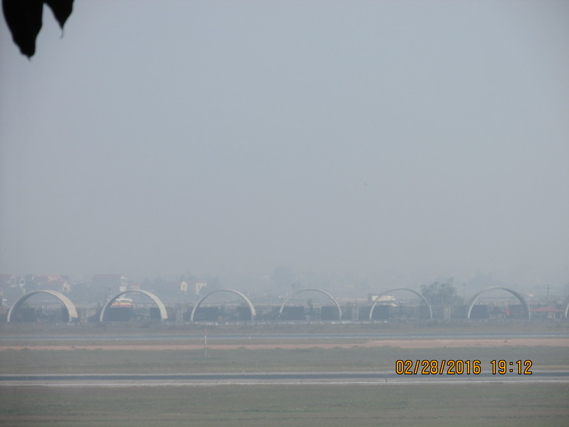 0099 - Airplane Bunkers from the Vietnam war to hide Jet Fighter Planes from Bombers at Hanoi Airport - Hanoi Vietnam - Date Correct but Time on Pic is Wrong