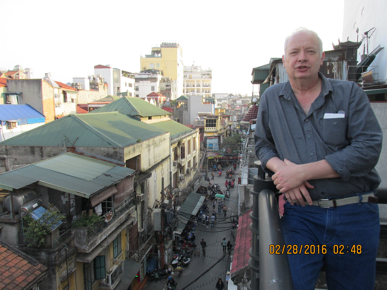 0031 - Brian on Balcony of Essence d'Orient Hotel overlooking Ta Hiem St in Old Quarter - Hanoi Vietnam - Date Correct Time on Pic is Wrong