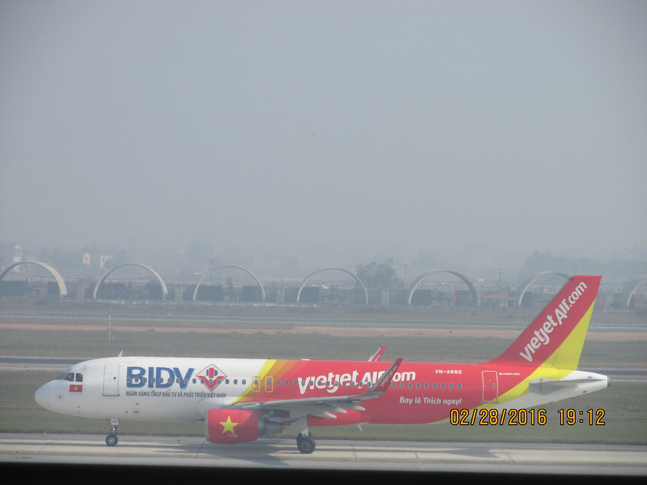 0100 - Vietjet Air Airplane from Vietnam at Hanoi Airport - Hanoi Vietnam - Date Correct but Time on Pic is Wrong