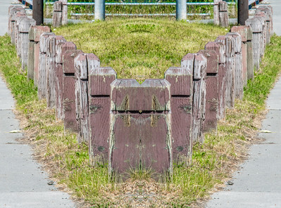 Repetition, line--Mirror image of posts tin Anchorage.