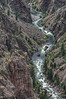 Looking down at the Gunnison River winding through the rock.