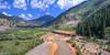 Drone shot of the Durango Silverton train tracks, crossing over the Animas River. Silverton in the distance.
