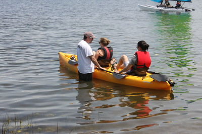 Boat Works Ltd. Representative Rob Jerry helping newbies in the Kayak