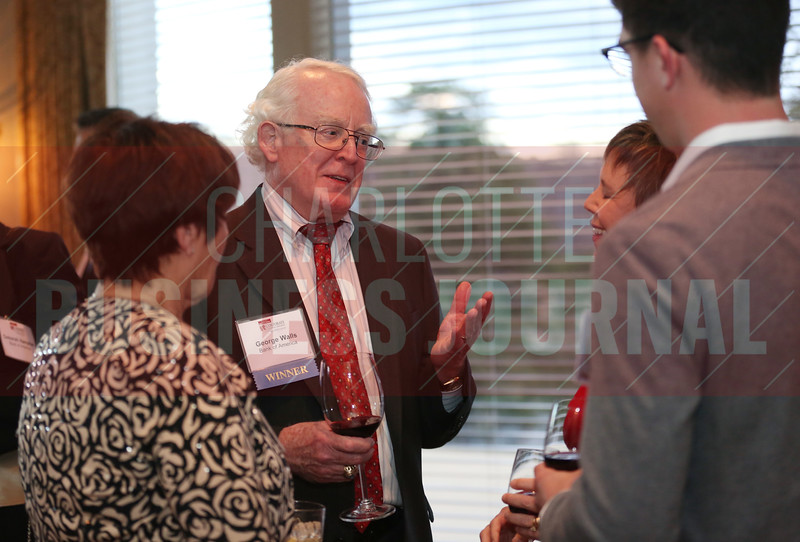 George Walls, Lifetime Achievement winner, enjoy drinks with friends and colleagues before the start of the Corporate Counsel awards ceremony.