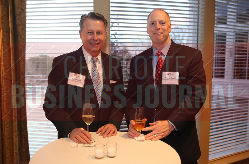 Mark Gasior and Dwayne Baxley of Simile Imaging Solutions pose for a photo before the start of the Corporate Counsel Awards.