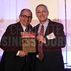 Stephen Tsoris accepts his award in the Outstanding General Counsel attorney size of 11-29 category.