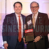 David Broome accepts his awards in the Outstanding General Counsel attorney size of 2-10 category.