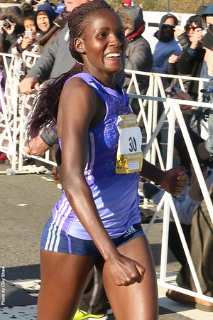 Women's winner Veronicah Nyaruai Wanjiru crosses the finish line