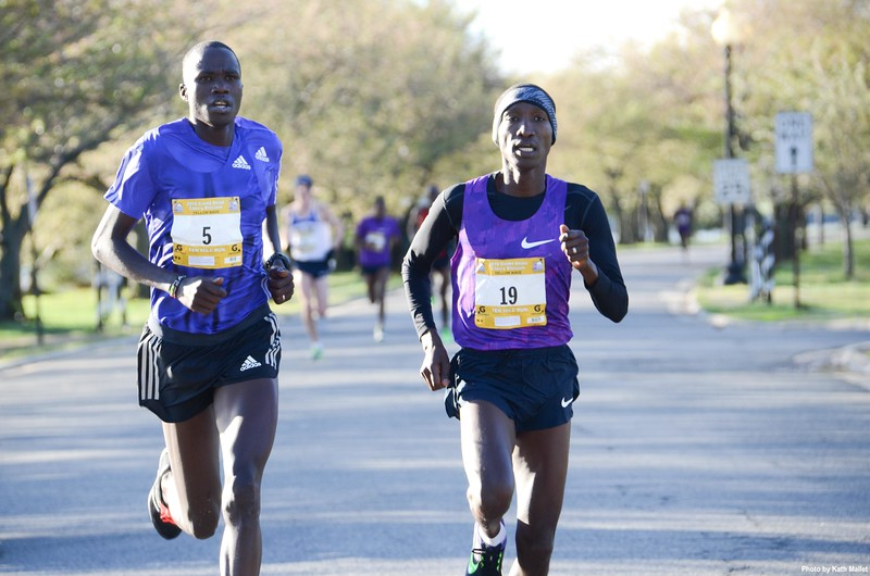 Eventual winner Sam Chelanga (#19) battles 2nd place finisher Silas Kipruto (#5)