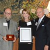 Honoree Paula Short received an Alumni Achievement Award. She poses with faculty member George Noblit and Mike Priddy.