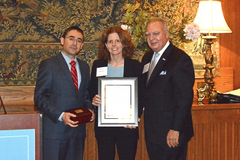 Honoree Alisa Chapman, center, recipient of the Peabody Award, the School's highest honor, poses with Dean Fouad Abd-El-Khalick, left, and Alumni Council Chair Mike Priddy.