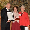 Mallory Nickel, center, receives the Outstanding Young Alumna Award from Alumni Council Chair Mike Priddy and Barbara Chapman.