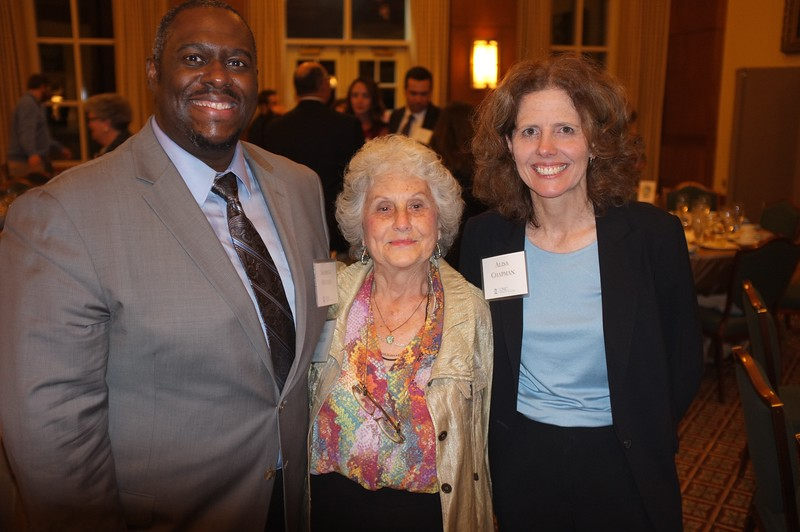 Faculty member Sherick Hughes poses with Rebecca Miller and Alisa Chapman.