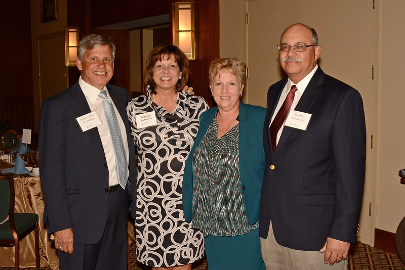 Honoree Zoe Locklear, third from left, poses with UNC-Pembroke Chancellor Robin Cummings, his wife, Rebecca Cummings, and Locklear's husband, Thomas Locklear.