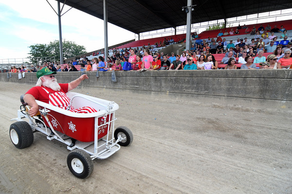 Larry Black of the Illinois Central Santas waves to the grandstand crowd Sunday afternoon during the Twilight Parade at the Effingham County Fairgrounds in Altamont.<br /> Chet Piotrowski Jr. photo/Piotrowski Studios