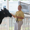 Casey Vonderheide leads her cow around at the dairy cow competition at the Effingam County Fair.<br /> Trent Pearcy photo
