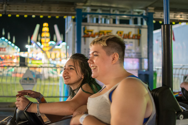 Jordan Bowler, left, and her friend, Jacque McKelvey, ride in the bumper cars at the Effingham County Fair.<br /> Trent Pearcy photo