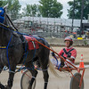 Jaded Truth and his driver Randal Fin won first place in the second harness race at the Effingam County Fair on Tuesday.<br /> Trent Pearcy photo