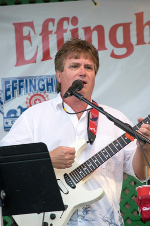 Larry Quick, one half of the Folk/Classic Rock band Quick and<br /> Bradley, performs on the free stage at the Effingham County Fair.<br /> Trent Pearcy photo