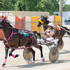 Pamela Coleman and her horse, Josting Jack, maintain<br /> their lead against Jackson Loy and his horse, Feel My Pain.<br /> Trent Pearcy photo