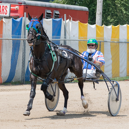 Raymond Morgan and his horse, Hillcrest Dynamite, race<br /> around the track at the Effingam County Fair.<br /> Trent Pearcy photo