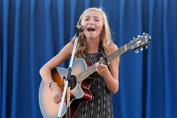 Grace Hoene performs in the junior division of the talent show Friday evening at the Effngham County Fair in Altamont. Hoene won the junior division of the talent show. <br /> Chet Piotrowski Jr. photo/Piotrowski Studios