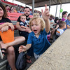 "Three-year-old Atticus Osteen of Altamont races down the grandstand to ""CAN-DYYYYYYY!"" to meet the oncoming parade participants Sunday afternoon during the Twiight Parade at the Effingham County Fair in Altamont.<br /> Chet Piotrowski Jr. photo/Piotrowski Studios"