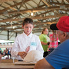 Alexis Van Dyke, left, tells showmanship judge Dave<br /> Zimmerman about how she takes care of her rabbit.<br /> Trent Pearcy photo