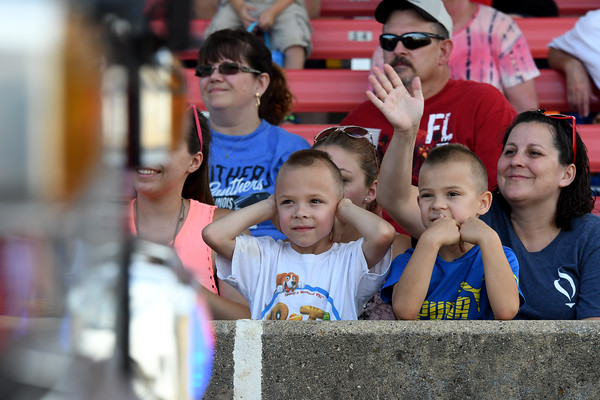 Six-year-old twins, Klayten and Jayden Kraus of Effingham, watch first responder vehicles drive past them during the Twilight Parade Sunday afternoon at the Effingham County Fairgrounds in Altamont.<br /> Chet Piotrowski Jr. photo/Piotrowski Studios