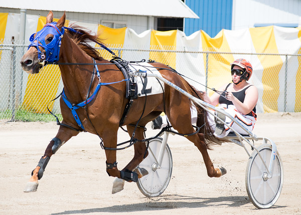 Angela Coleman gets her horse, Perfectly Clear, warmed up to race at the Effingam County Fair.<br /> Trent Pearcy photo