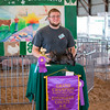 Blake Esker and his three rabbits won the Grand Champion award in<br /> the rabbit meat pen category at the Effingam County Fair on Wednesday.<br /> Trent Pearcy photo