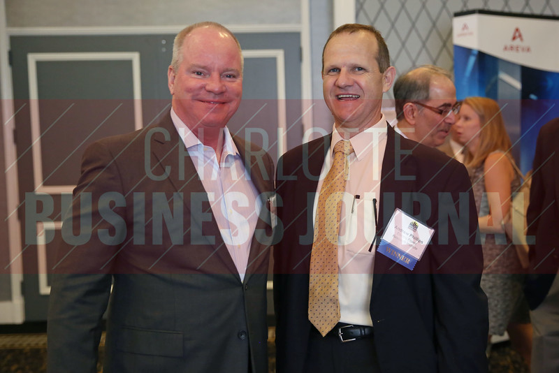 Matt Olearczyk poses for a photo with award winner Andrew Phillips of Electric Power Research Institute.