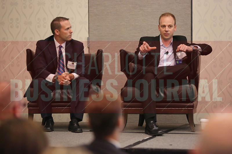 Clayton Summers and Bill Lacivita discuss future energy tech during a breakoff session.