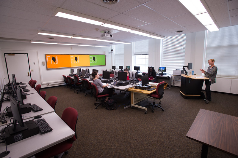 Students and faculty working in creative writing computer lab.