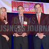 Joe Brogdon, CFO / COO, Catholic Charities of Dallas, center, receives his award from Tiffany Cason and Rick Rodman of Capital One Commecial banking.