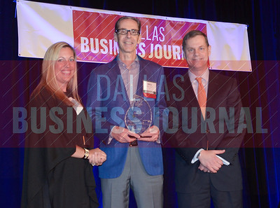 Rick Simonson, CFO, Sabre, center, receives his award from Tiffany Cason and Rick Rodman of Capital One Commecial banking.