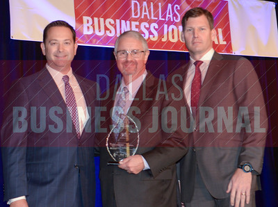 Rob Lloyd, CFO, GameStop Corp., center, receives his award from Jason Downing and Dan Berner of Deloitte.