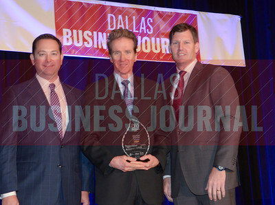 Stuart Lodge, CFO, Optimal Blue, center, receives his award from Jason Downing and Dan Berner of Deloitte.