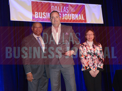 Rob Rose, CFO, Worldwide Express, center, receives his award from Dr. Chandra Subramamaniam and Dr. Jennifer Ho of University of Texas at Arlington College of Business.