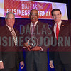 Tony Laday, CFO, Fogo de Chao, center, receives his award from Kenneth Judd and Kendall Helfenbein representing FEI.